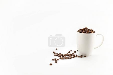 coffee beans in coffee mug