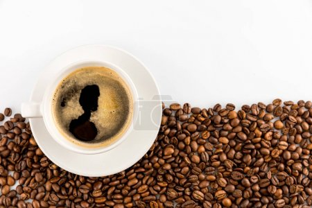 Photo for Cup of espresso coffee with coffee beans isolated on white with copy space - Royalty Free Image