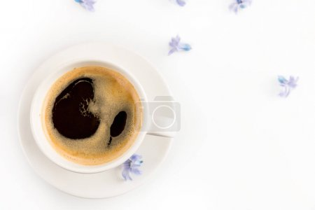 Cup of coffee and flowers