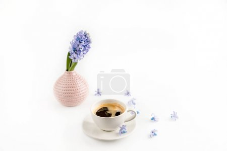 Photo for Close-up view of coffee mug and blue hyacinth flowers in vase - Royalty Free Image