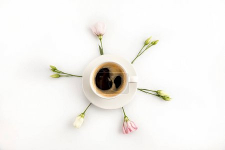 Photo for Top view of cup of hot fresh espresso coffee and beautiful pink flowers - Royalty Free Image
