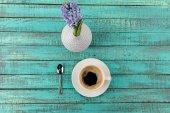Coffee mug steam and flowers on table