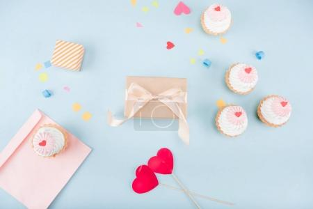 cakes and gift boxes with envelope