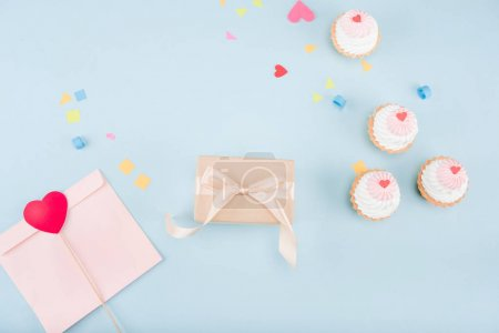 cakes and gift box with ribbon