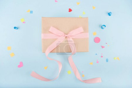 Photo for Top view of gift box with ribbon and confetti mock-up, birthday party - Royalty Free Image