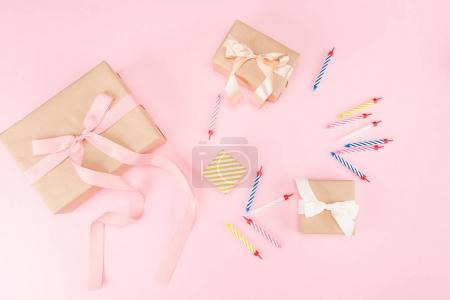 candles with gift boxes and confetti
