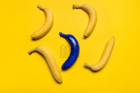 Photo for Top view of blue and yellow bananas isolated on yellow, ripe bananas - Royalty Free Image