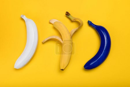 Photo for Top view of fresh colored bananas isolated on yellow, ripe bananas - Royalty Free Image
