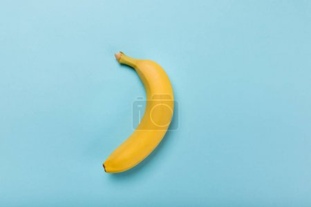 Photo for Top view of fresh yellow banana isolated on blue, colorful background - Royalty Free Image