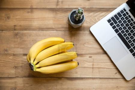 Ripe bananas and laptop