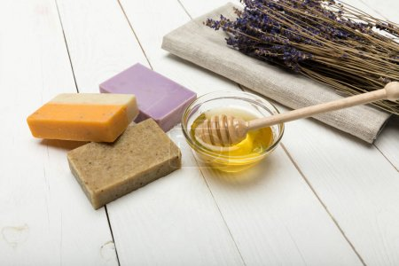 Photo for Close-up view of homemade soap collection with dried lavender flowers and honey - Royalty Free Image