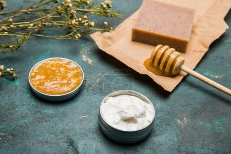 Photo for Close-up view of handmade soap, honey, dried flowers and cream for beauty care - Royalty Free Image