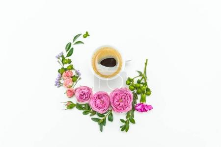 Photo for Top view of beautiful pink roses with green leaves and cup of coffee isolated on white - Royalty Free Image