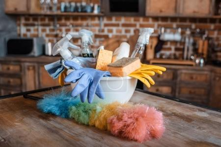 Photo for Close-up view of cleaning supplies on wooden table indoors - Royalty Free Image