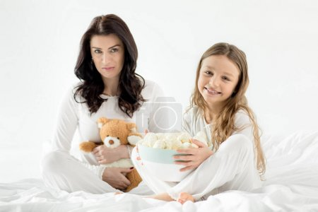 Daughter and mother with marshmallow