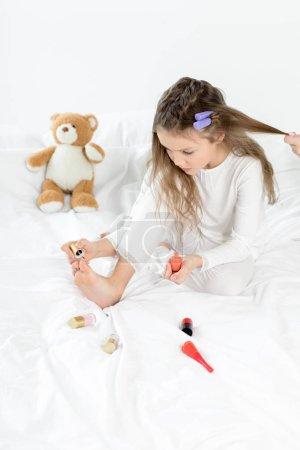 Girl applying nail polish