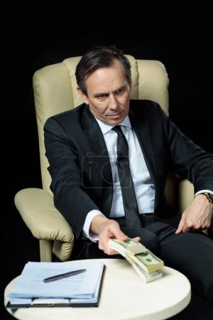 Mature businessman in chair