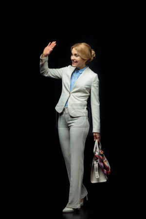 blonde businesswoman waving