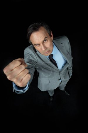 businessman showing fist