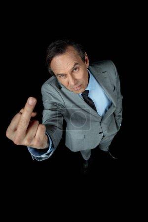 businessman showing middle finger up