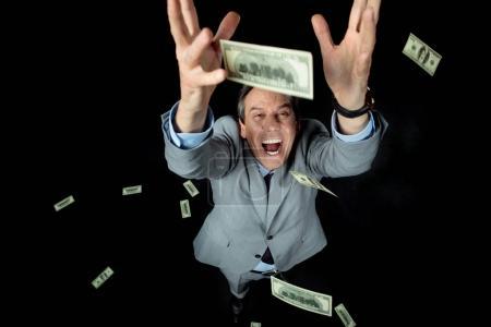 businessman catching dollars