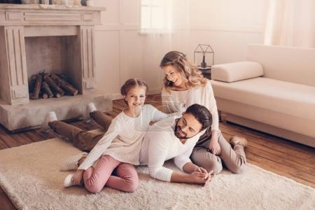 Photo for Happy young family with one child spending time together at home - Royalty Free Image