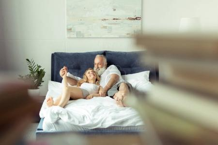 couple relaxing on bed