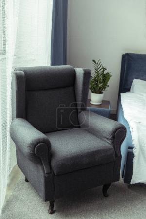 modern armchair in bedroom