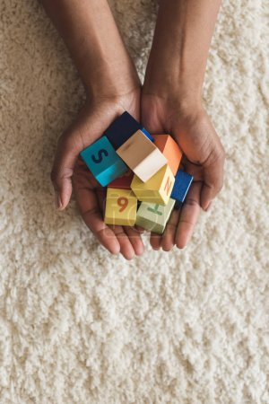 woman holding cubes