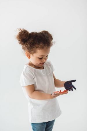 little kid girl with painted hands