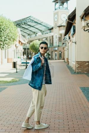 stylish man with shopping bag