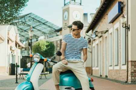 Man sitting on scooter