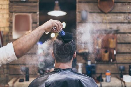 Man getting hairstyle