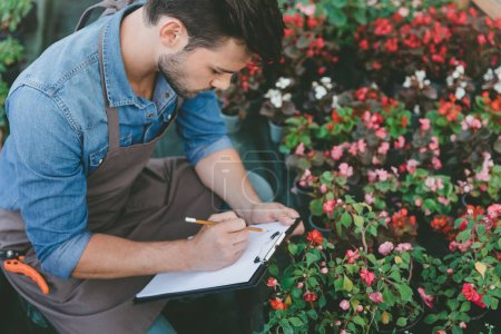 gardener making notes during work