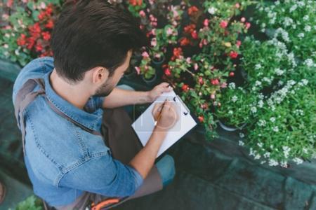 gardener making notes during work
