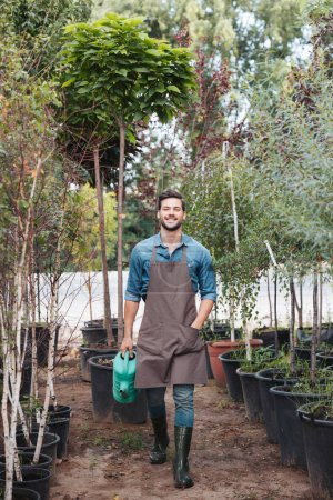 gardener with watering can in hand