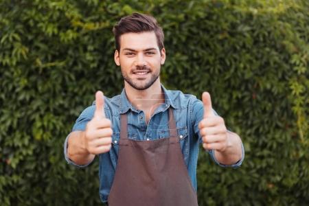 Gardener showing thumbs up