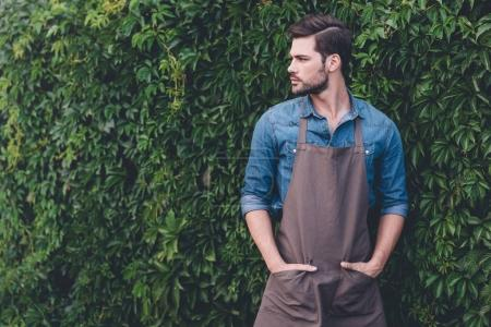 thoughtful gardener in apron
