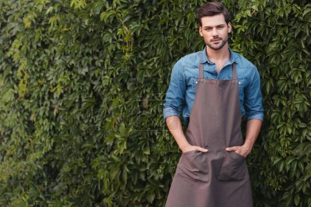 Thoughtful gardener in apron