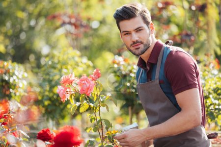Gardener with coffee to go in garden