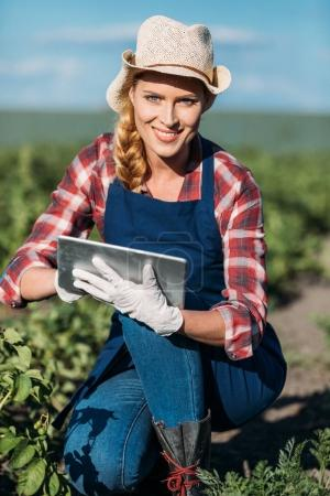 Farmer working with digital tablet