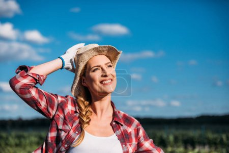 smiling young female farmer