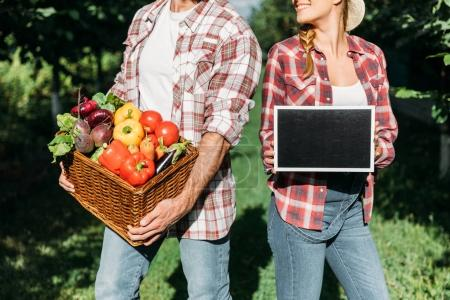 farmers with harvest and chalkboard