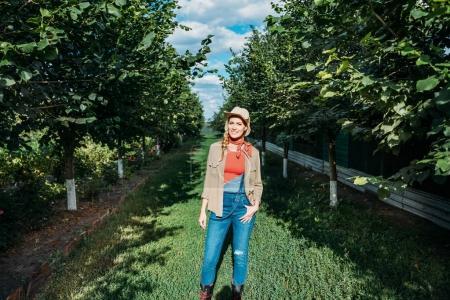 confident farmer in orchard