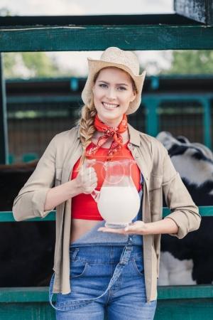 farmer with milk in glass jug