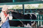 farmer with fresh milk in stall