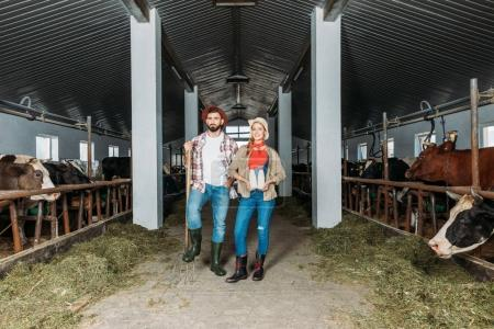 farmers with fresh milk at cowshed