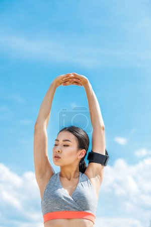 Asian sportswoman stretching