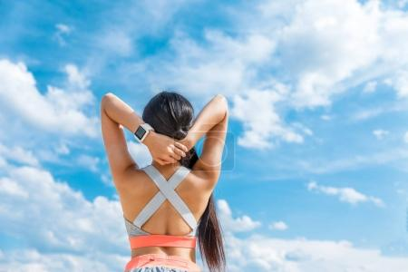 Sportswoman with smart watch
