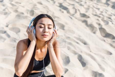 asian woman listening music